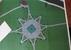 A térrendezési terv csillag alakú térkövezést mutat az emlékmű körül - miniatűr változat