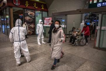 Megérkeztek Kínába a WHO szakértői a vírus eredetének felkutatására - A cikkhez tartozó kép